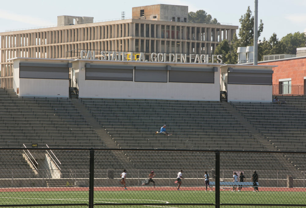 CORRECTS TO ORDER ISSUED LATE WEDNESDAY Students practice track at the Cal State University, Los Angeles campus Thursday, April 25, 2019. A quarantine order was issued late Wednesday for hundreds of students and staff at two Los Angeles universities, including Cal State University, who may have been exposed to measles and either have not been vaccinated or can't verify that they have immunity. (AP Photo/Damian Dovarganes)