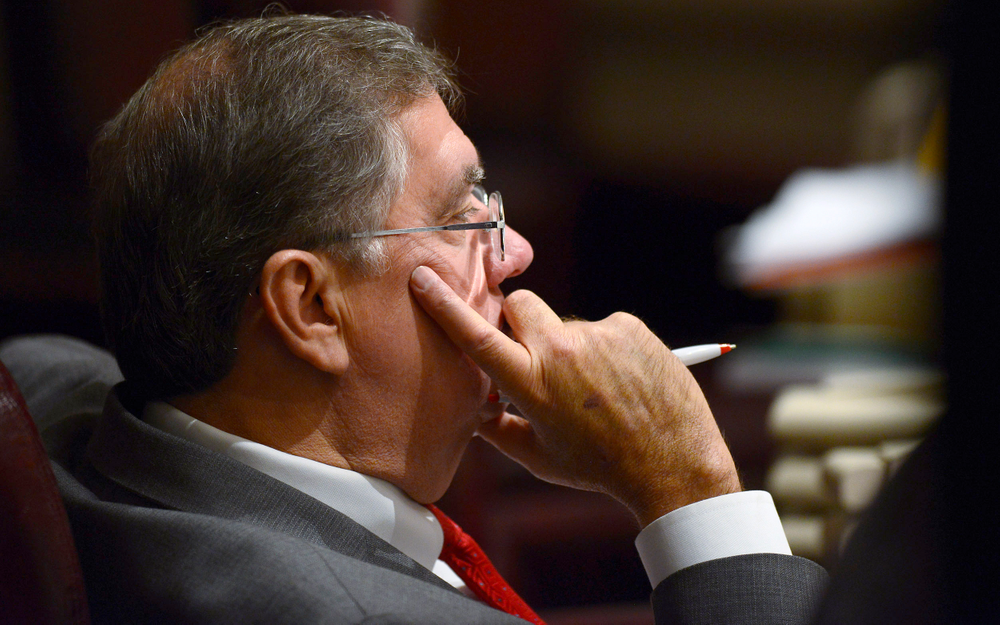FILE - In a Feb. 12, 2014 file photo, Rep. Steve Hurst, R-Munford, watches discussion on the house floor in the Alabama Statehouse in Montgomery, Ala. Alabama lawmakers have approved legislation that would require certain sex offenders to be chemically castrated before being released on parole. The Alabama bill, sponsored by Republican Rep. Steve Hurst, would require sex offenders whose crimes involved children younger than 13 to receive the medication before being released from prison on parole. They would then be required to continue the medication until a judge decided they could stop.   (Mickey Welsh/Montgomery Advertiser via AP)