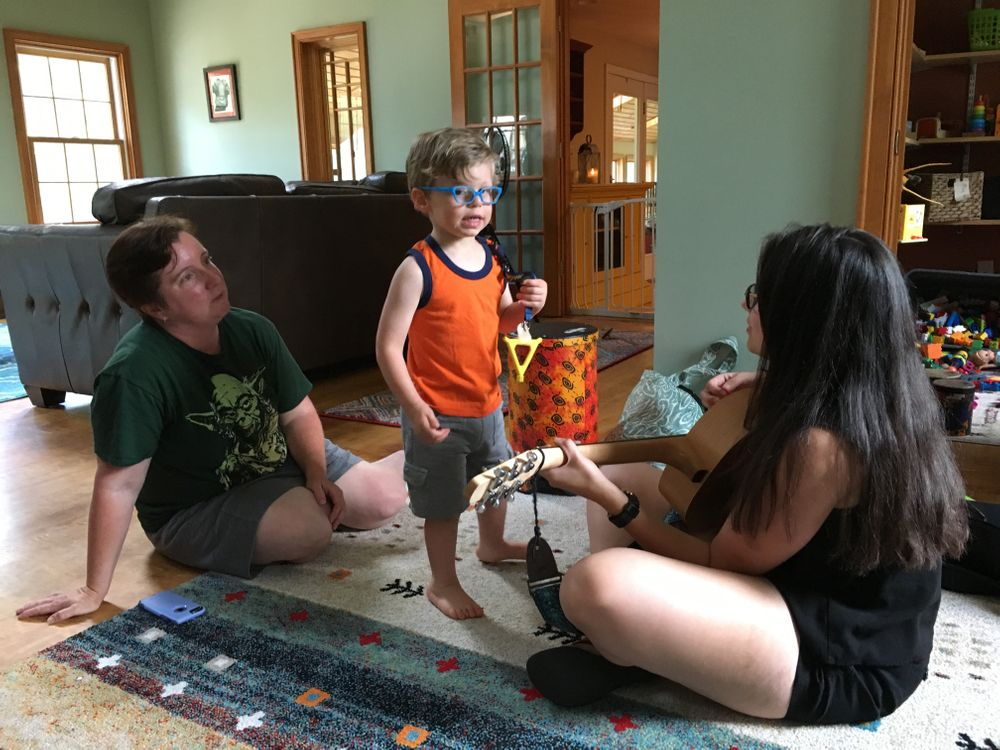 Ally and Matt pay for Joanna, a neurologic music therapist, to come to their home for sessions with James.