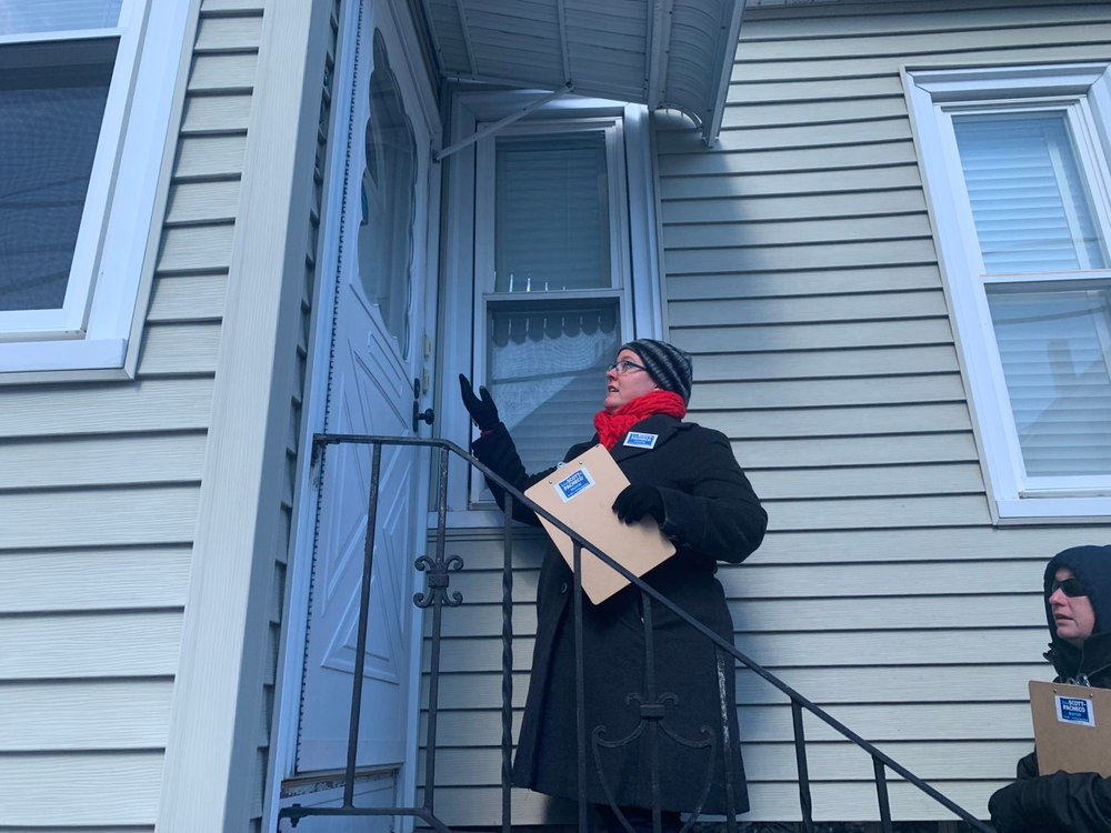 Nonprofit worker and mayoral candidate Erica Scott-Pacheco canvases registered voters on a freezing cold weekday morning in fall river.