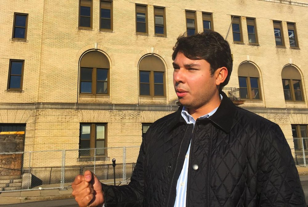 Fall River Mayor-elect Jasiel Correia stands in front of the city's former police station.