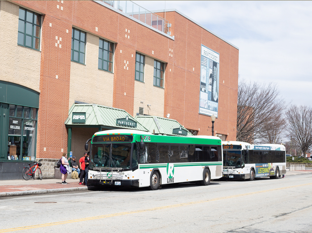 Riders board the R-Line bus at the downtown hub.