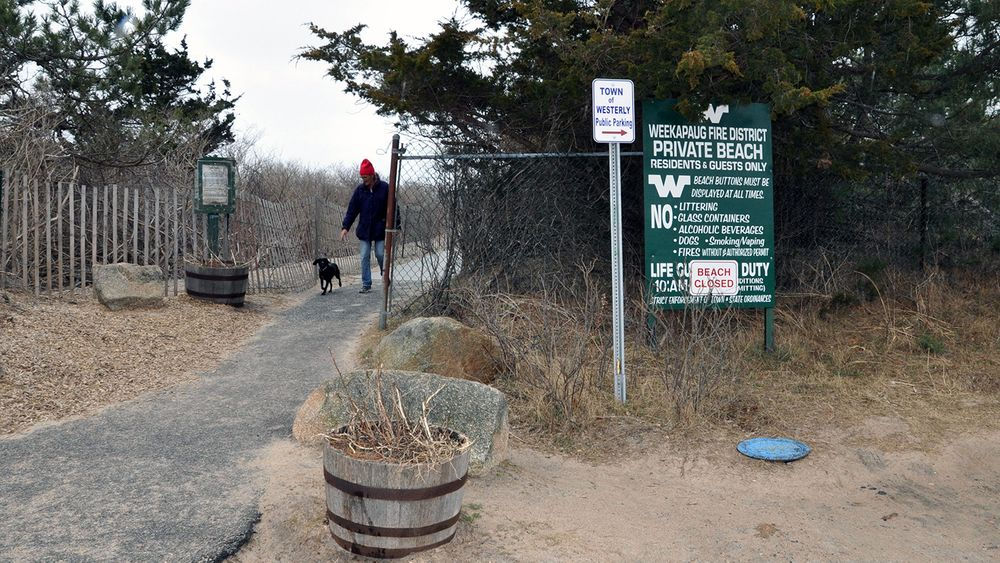 The private entrance to a boardwalk down to the ocean at the start of the Weekapaug Barrier Beach in Westerly.