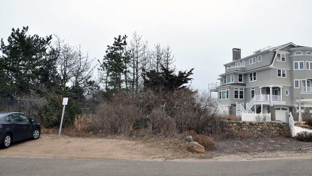 A once open path down to the beach in Weekapaug is overgrown with vegetation, fenced off, and claimed by the Weekapaug Fire District. The Rhode Island Coastal Resources Management Council is reviewing whether it's really a public right of way.