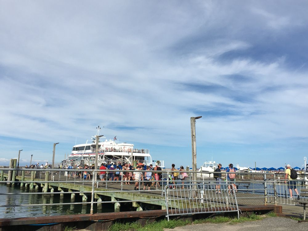 People line up for the ferry to New London, CT on Friday.