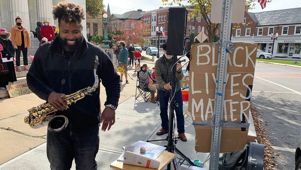 Kevin Lowther, aka Big Lux, plays at a gathering of activists in downtown Westerly on Saturday, Oct. 24, 2020.