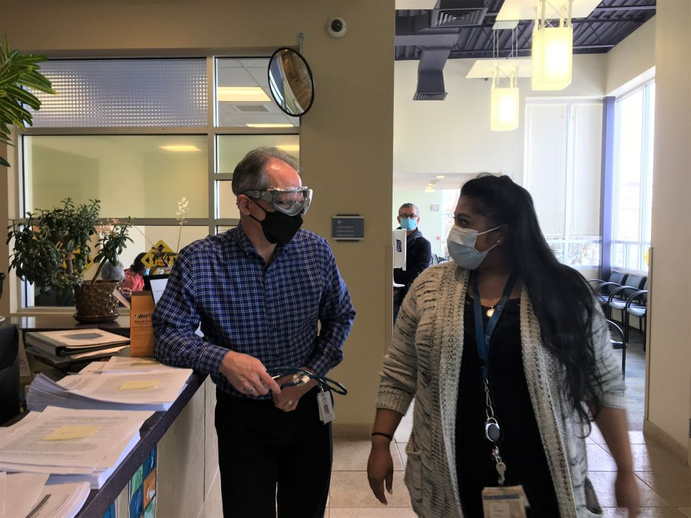 Dr. Andrew Saal and Dr. Nadine Hewamudalige at a vaccine clinic at the Providence Community Health Centers in February.
