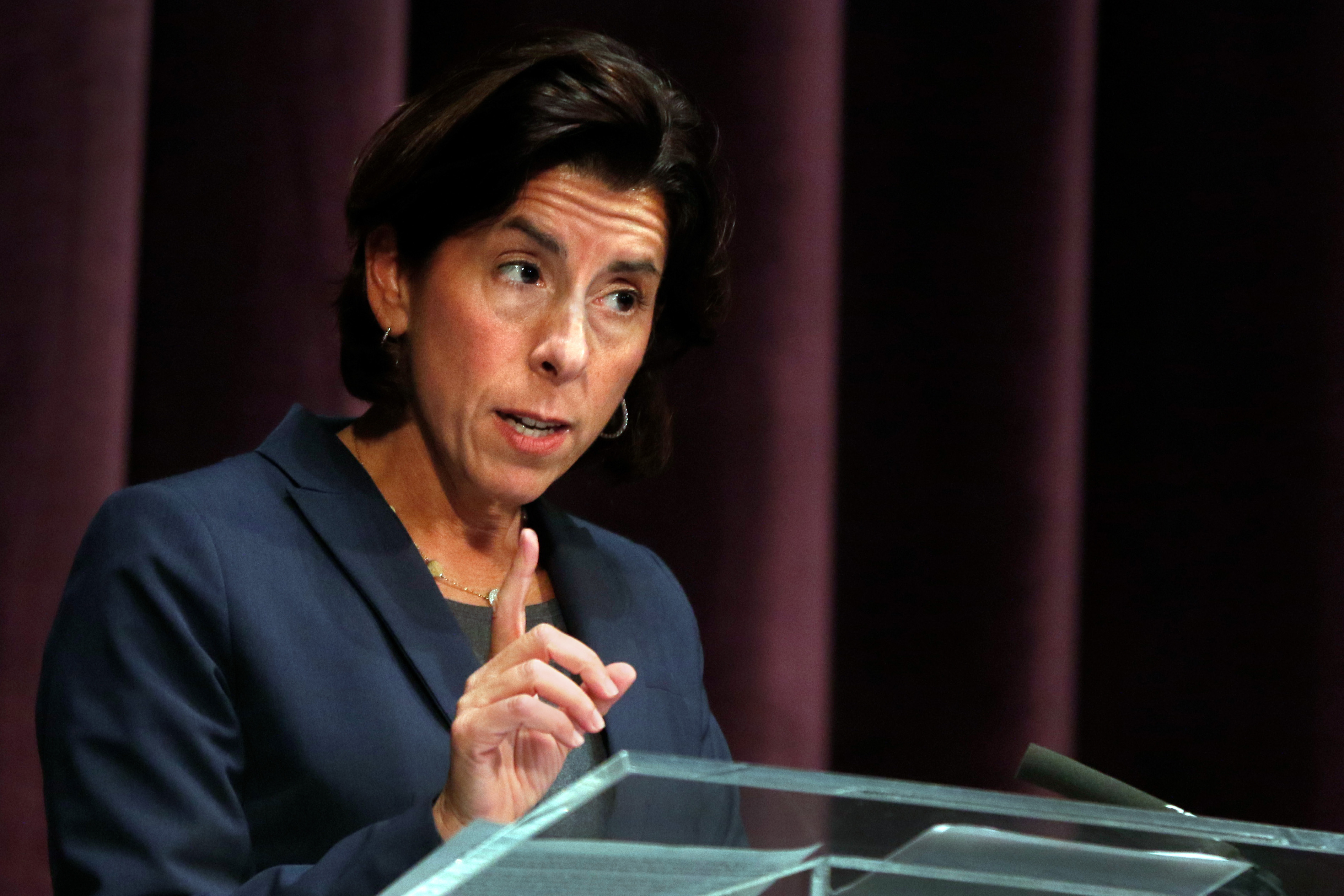 Gov. Gina Raimondo warns at a news briefing Wednesday that she plans to announce new restrictions to curb the spread of the coronavirus.