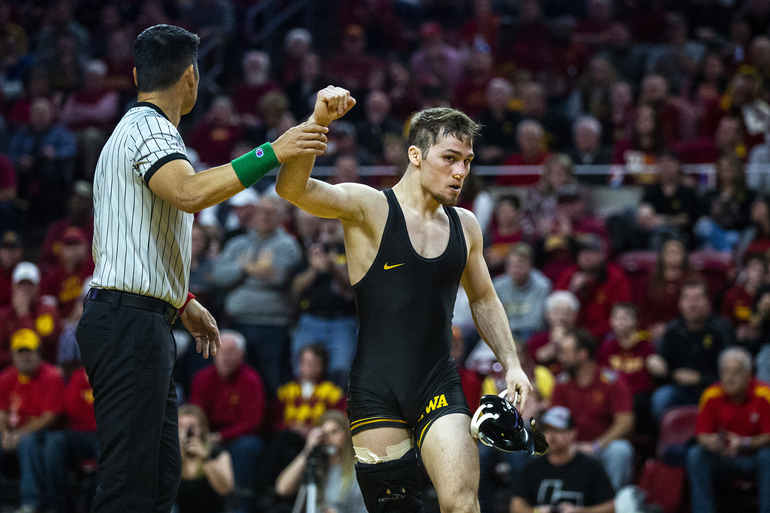 FILE - In this Nov. 24, 2019, file photo, Iowa's Spencer Lee wins by technical fall against Iowa State's Alex Mackall at 125 pounds during the Cy-Hawk dual wrestling match at Hilton Coliseum, in Ames, Iowa. Lee and Oregon women's basketball star Sabrina Ionescu shared the Sullivan Award on Wednesday night, April 29, 2020, as the country's top amateur athlete. (Kelsey Kremer/The Des Moines Register via AP, File)