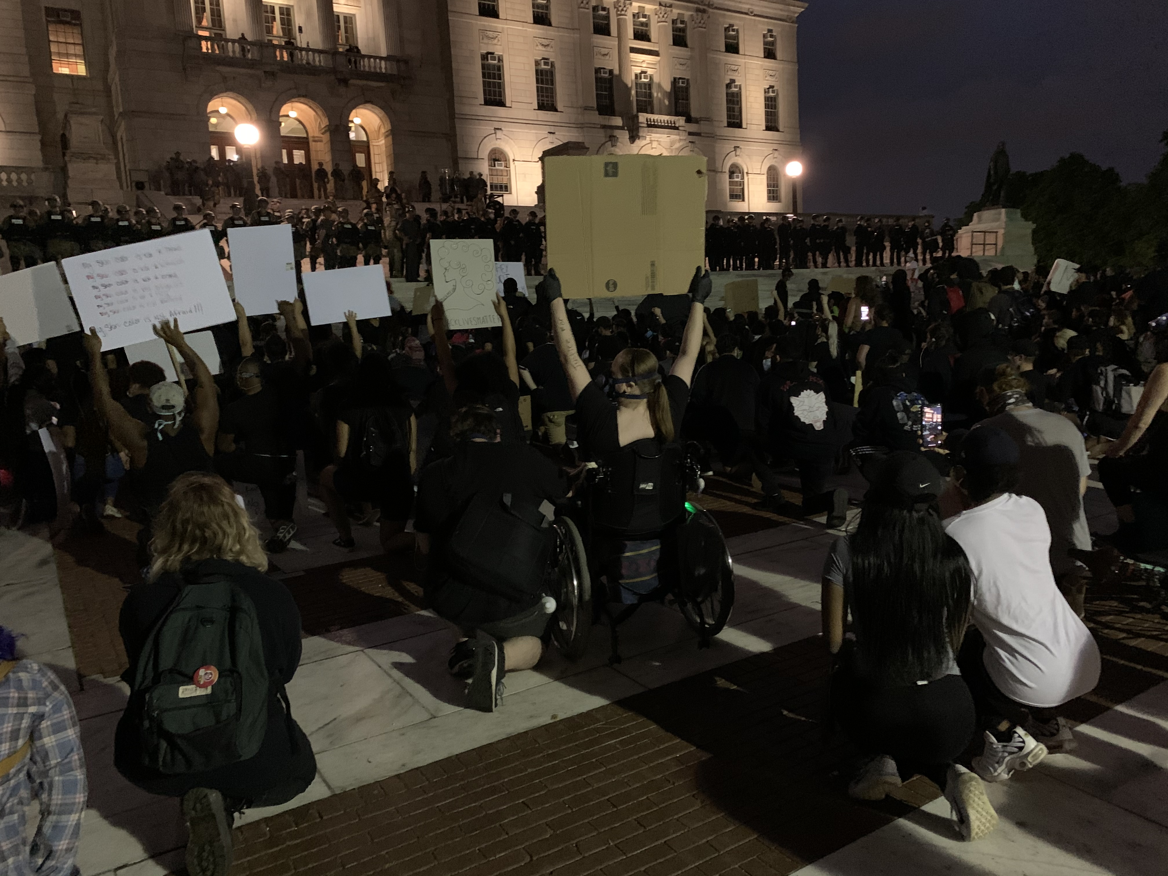 Protesters broke Providence's 9 pm curfew to continue demonstrating outside the Rhode Island State House.