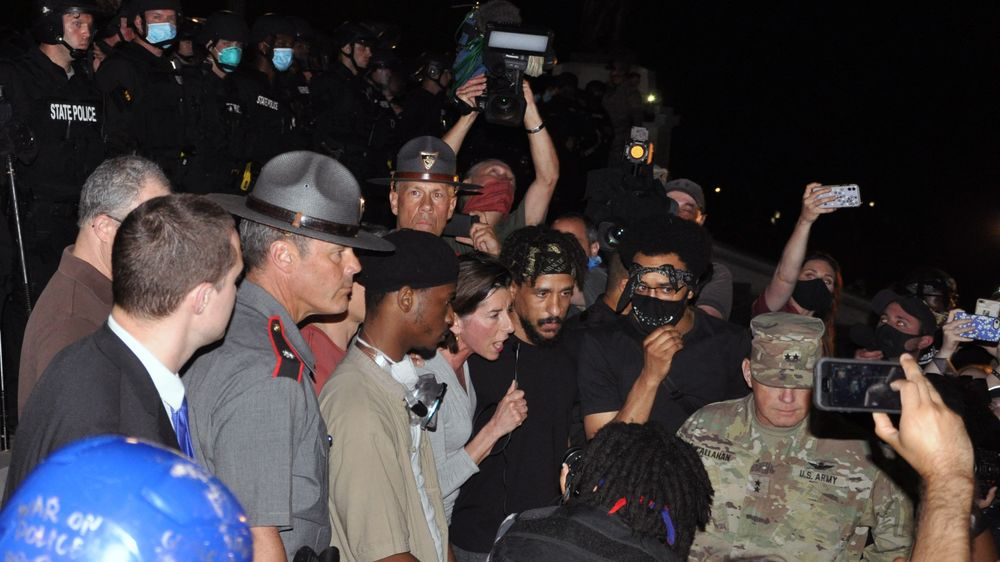 Rhode Island Gov. Gina Raimondo appeals to protesters to leave the State House Friday night