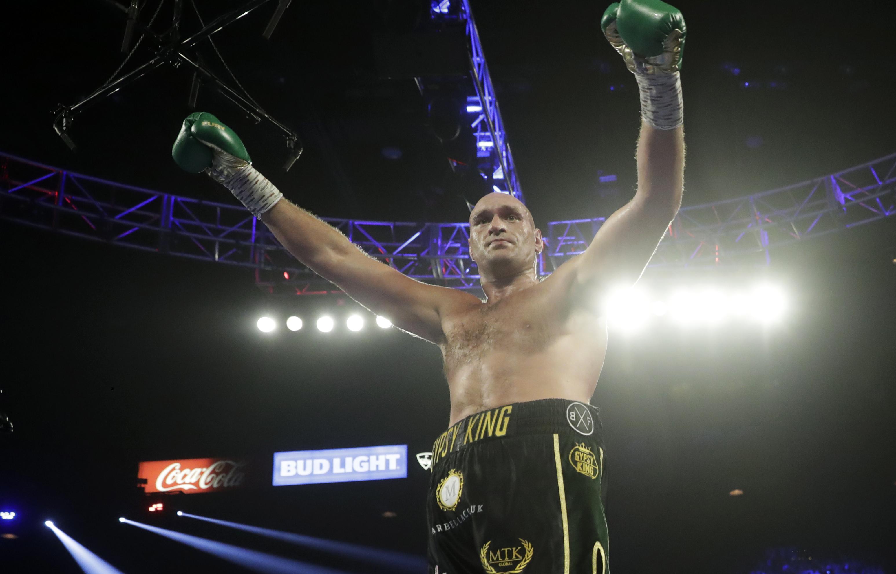 Tyson Fury, of England, celebrates during a WBC heavyweight championship boxing match against Deontay Wilder Saturday, Feb. 22, 2020, in Las Vegas. (AP Photo/Isaac Brekken)