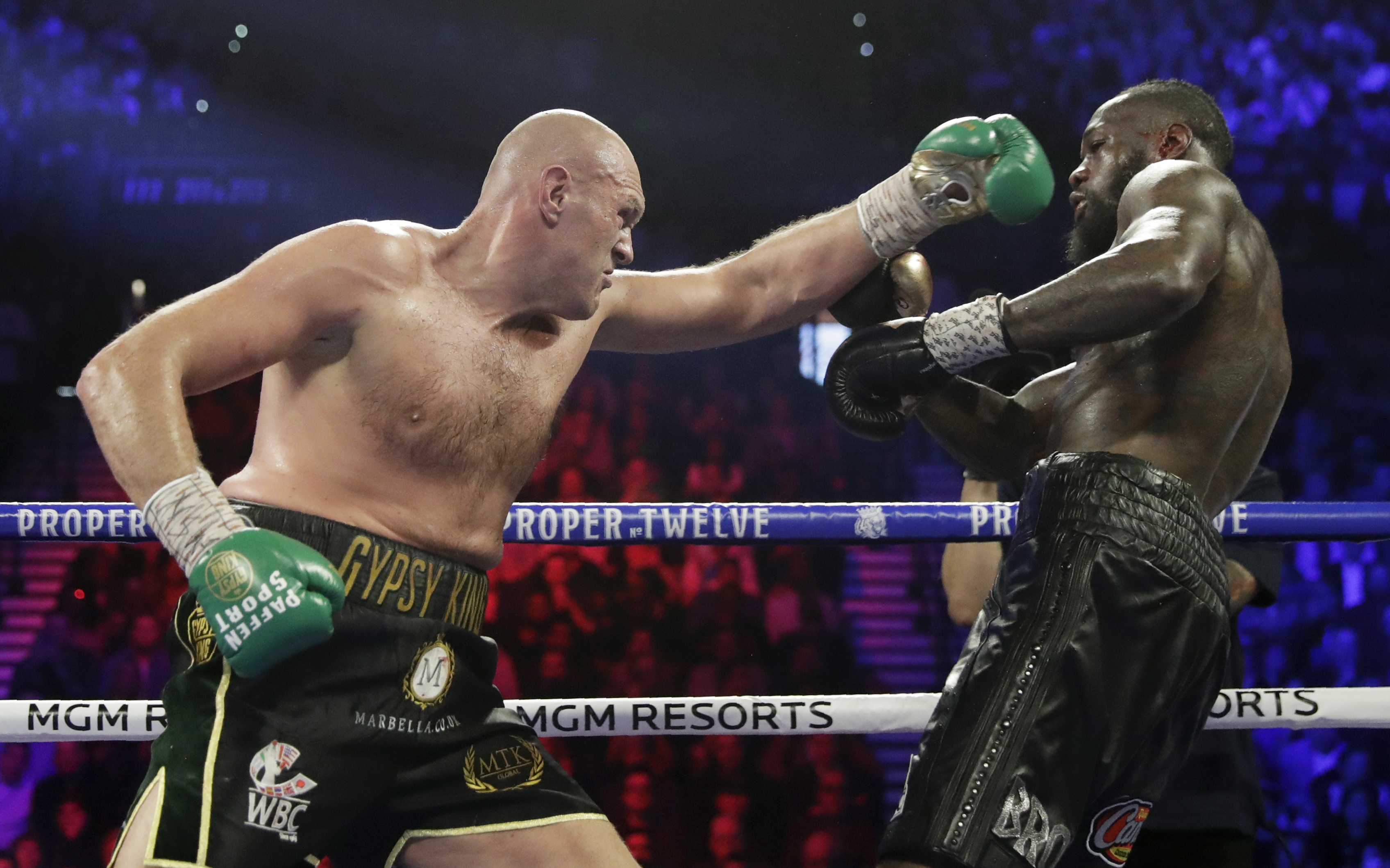 Tyson Fury, left, of England, fights Deontay Wilder during a WBC heavyweight championship boxing match Saturday, Feb. 22, 2020, in Las Vegas. (AP Photo/Isaac Brekken)