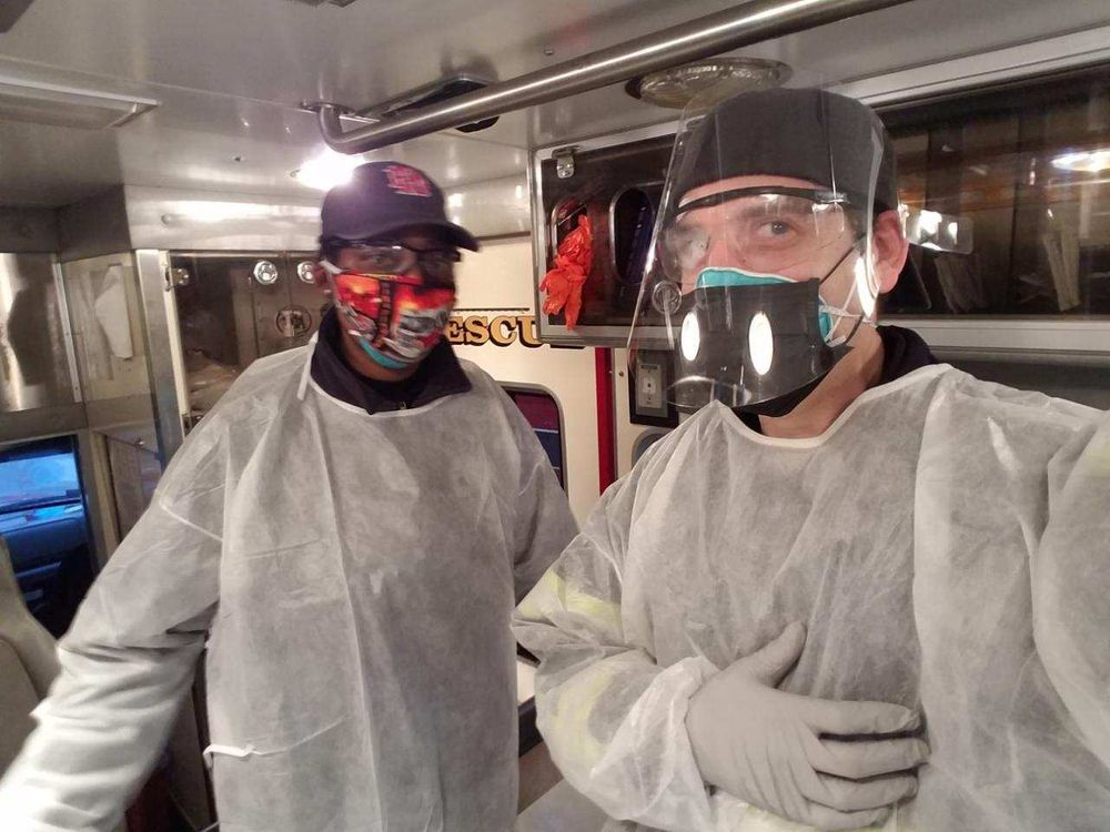 Providence EMS workers in protective gear for responding to suspected coronavirus cases.