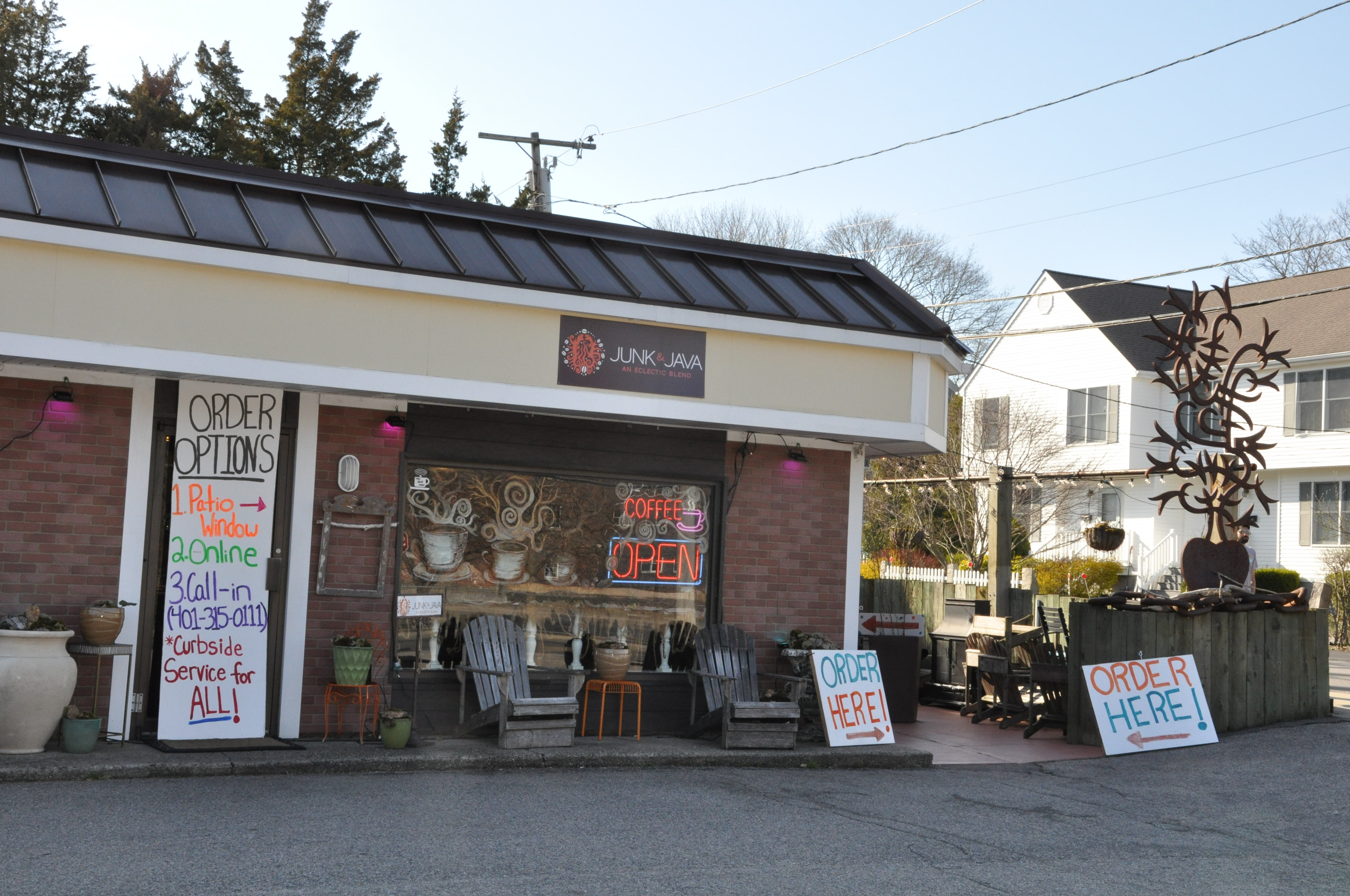 Junk & Java coffee shop in Westerly directs patrons to an order window at its side patio.