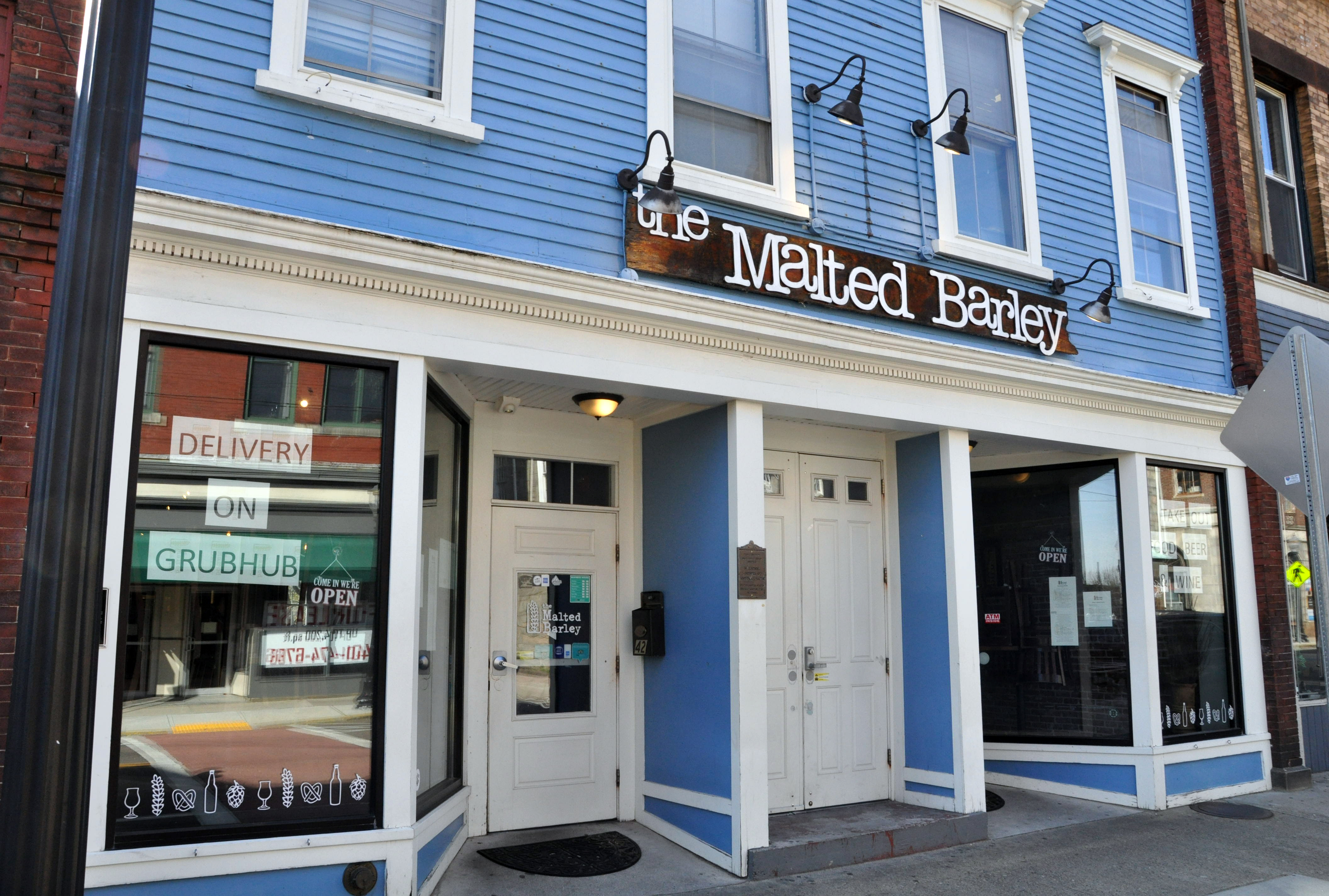 The Malted Barley in downtown Westerly advertises delivery service.