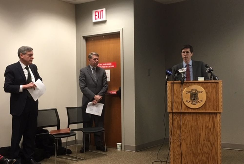 Brett Smiley, at the podium, during a budget presentation earlier this year.