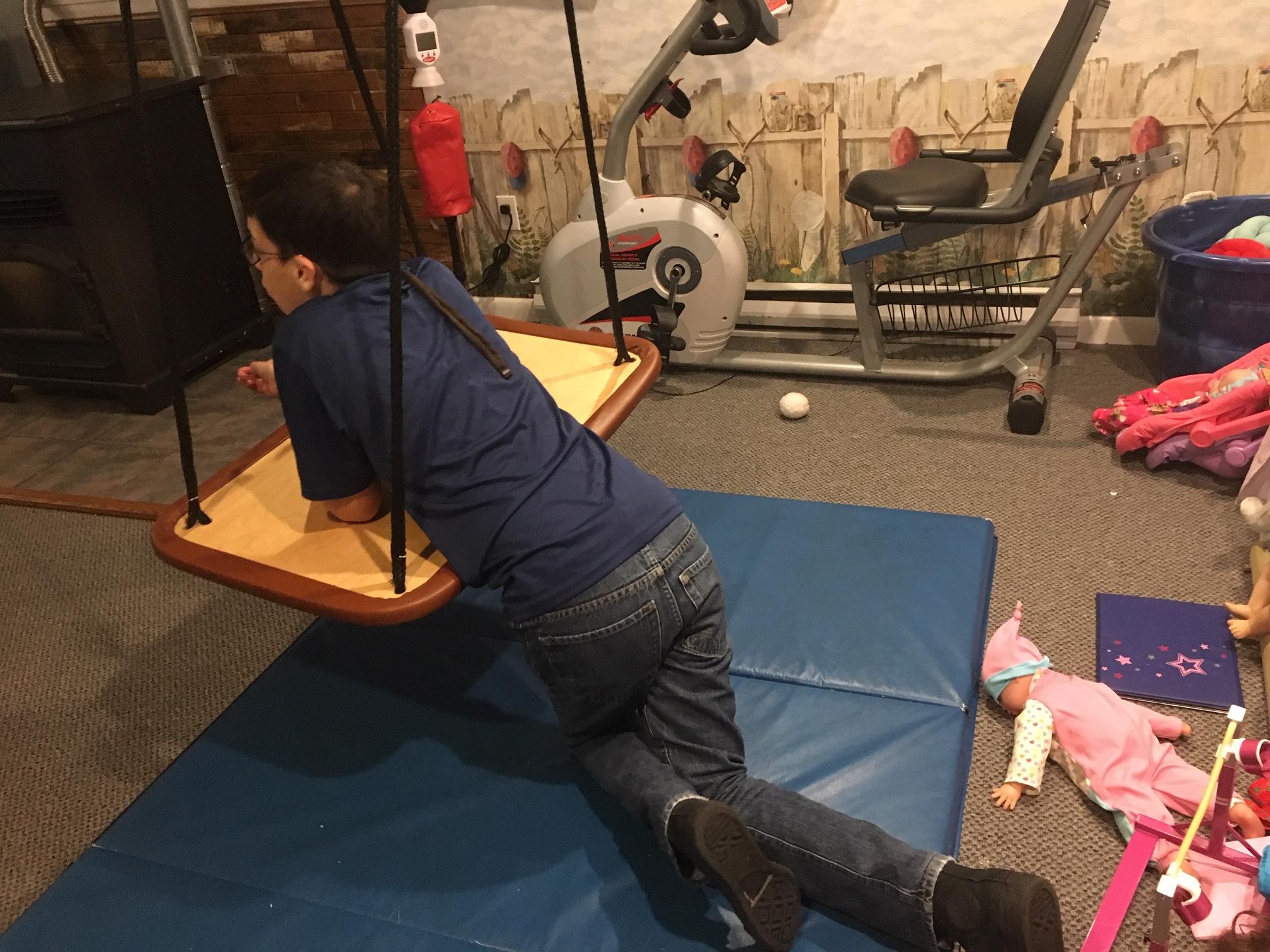 Dylan, 13, calms himself in his basement playroom