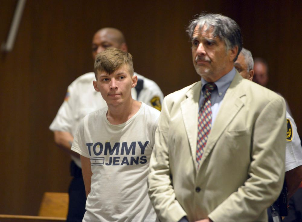 Volodymyr Zhukovskyy, 23, of West Springfield, stands with his attorney Donald Frank during his arraignment in Springfield District Court on Monday. Zhukovskyy was charged Monday with seven counts of negligent homicide.