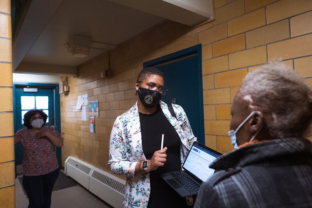 RI Sen. Tiara Mack, D-Providence, went door-to-door in the city's West End on Tuesday evening to sign up residents of color to receive COVID-19 vaccinations this weekend.