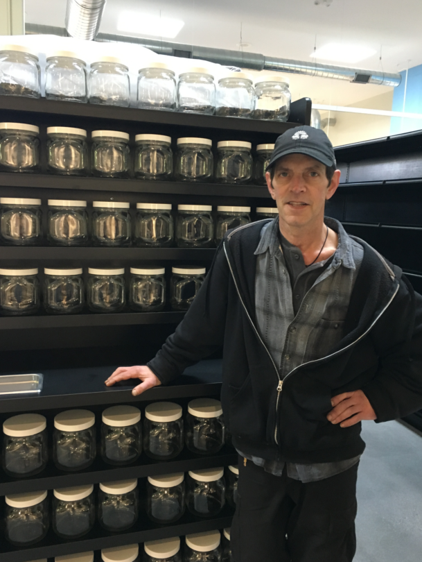Erb Reinert, bulk buyer for Urban Greens, stands in front of shelves ready to be filled.