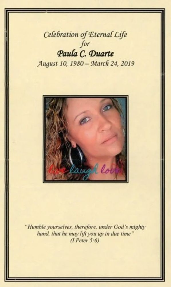 Paula Duarte's funeral pamphlet. When Duarte went into cardiac arrest, an EMT with advanced training inserted a breathing tube which a doctor later reported was blowing air into her stomach.