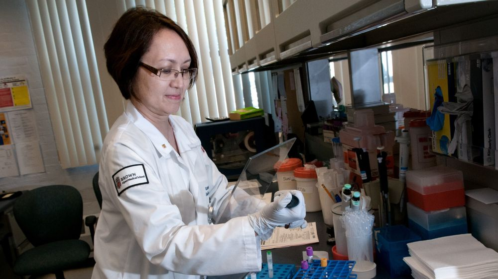 Dr. Karen Tashima, director of clinical trials at The Immunology Center at The Miriam Hospital, in Providence, RI, at work in her lab.
