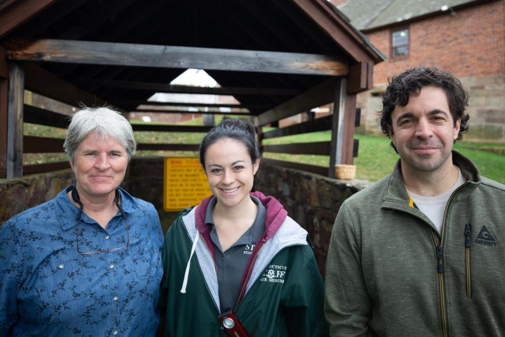 DEEP Biologist Kate Moran, left, with Old New-Gate site manager Morgan Bengel, and DEEP biologist Brian Hess, outside of the entrance to the mine at Old New-Gate Prison & Copper Mine.
