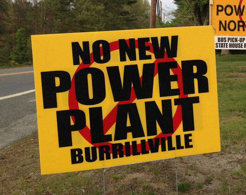 A yard sign opposing the construction of the power plant.