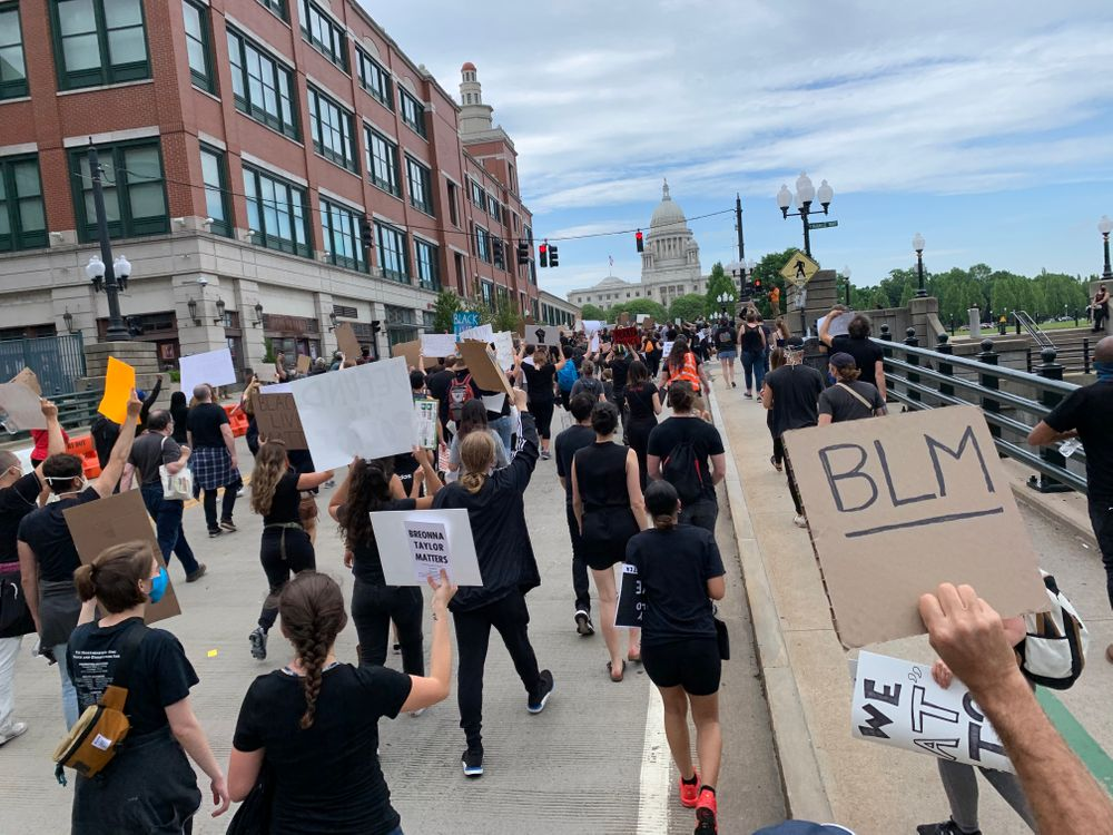 Protesters marching towards the Rhode Island State House.