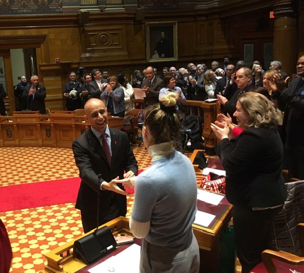 Elorza greets Councilor Kat Kerwin ahead of his address.