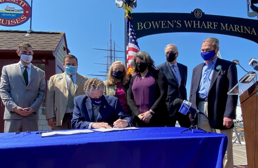 Gov. Dan McKee signed the Act on Climate April 10, 2021.
