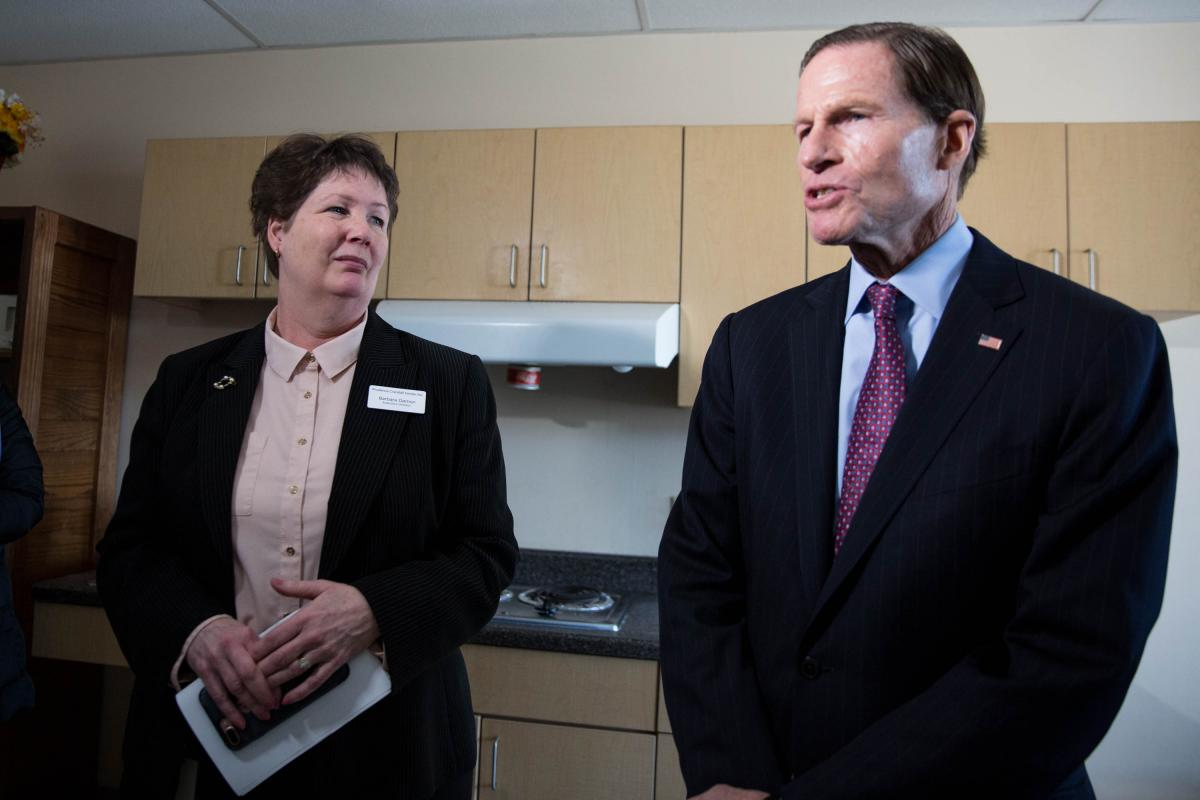 Barbara Damon (left) invited Senators Richard Blumenthal (right) and Chris Murphy to a tour of the Prudence Crandall Center on January 22, 2019. Her goal was to promote awareness around funding for domestic violence victims that's currently being withheld.