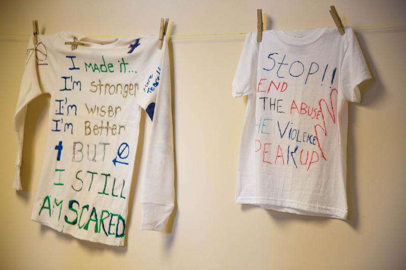 These shirts are hung at the Prudence Crandall Center in New Britain. The messages on them are meant to spread awareness of domestic violence.