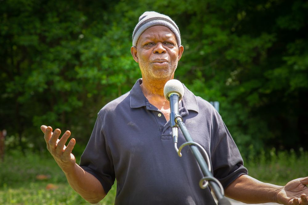 Julius Kolawole stands on Bami Farm, a project of the African Alliance of Rhode Island