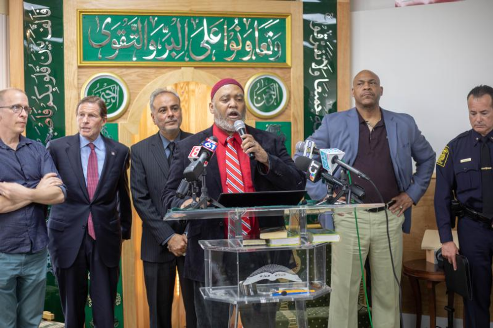 Imam Kashif Abdul-Karim (center) was joined by elected officials and law enforcement at press conference following a threat at the Muhammad Islamic Center of Greater Hartford.