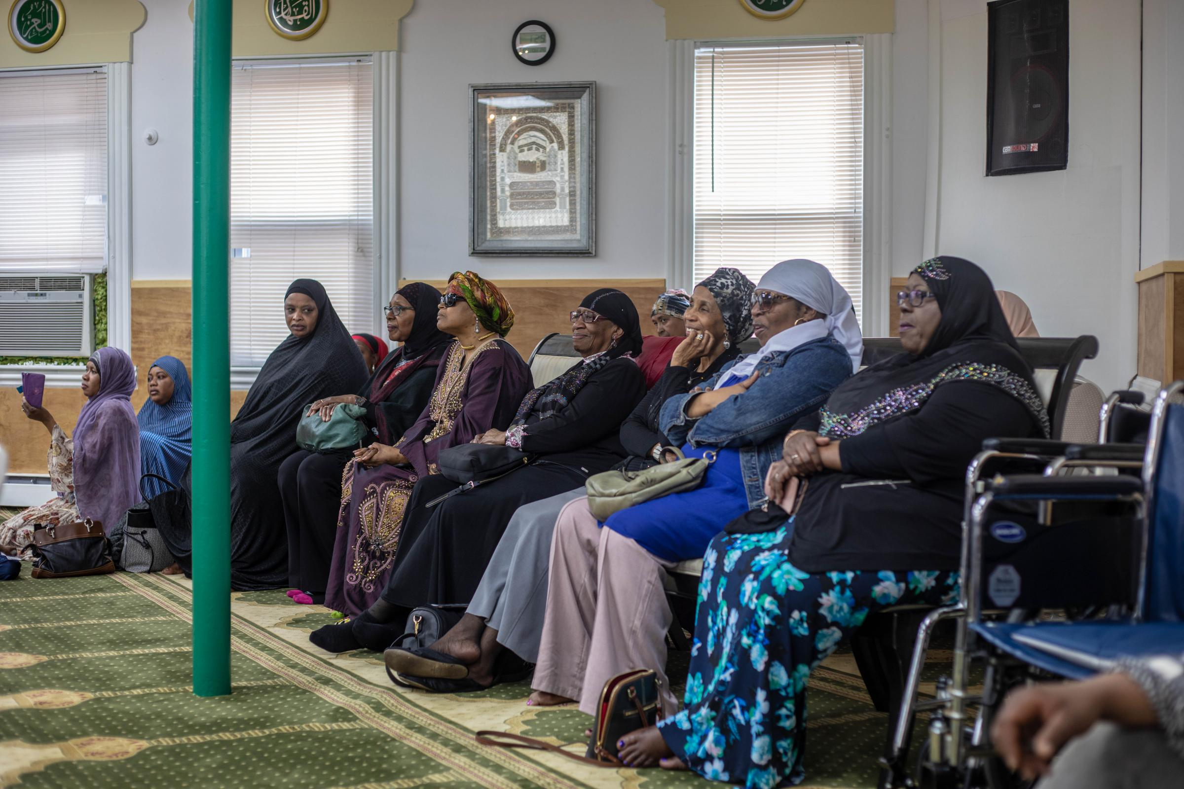 Members of the Muhammad Islamic Center of Greater Hartford listen during the press conference.