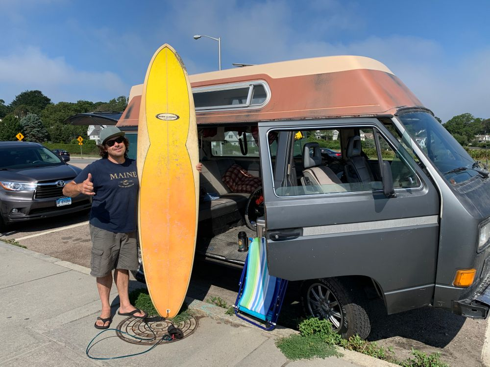 Jeff Vibert poses with his surfboard and camper van at Easton's Beach.
