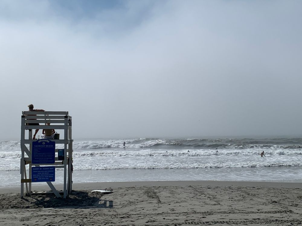 Large waves from Tropical Storm Isaias attract surfers to Newport beaches