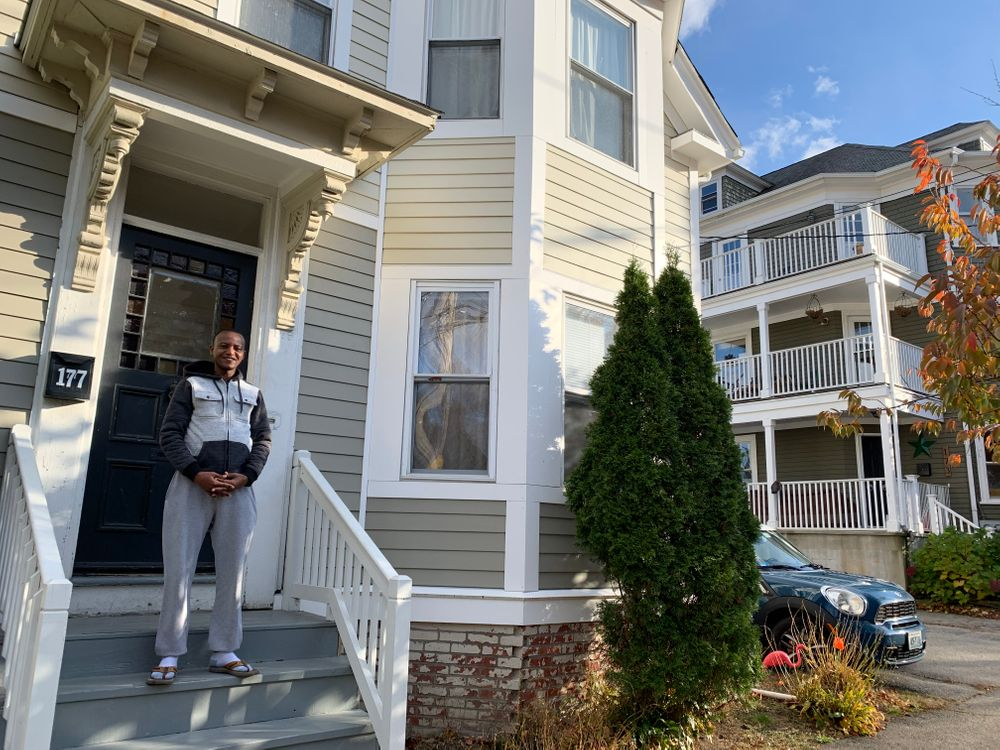Alphonse Mupenzi outside of his home in Providence