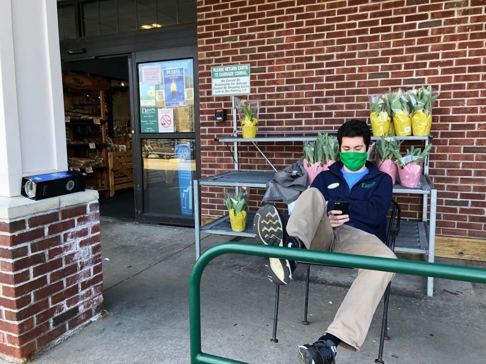 A grocery store employee at Dave's Marketplace is pictured here.