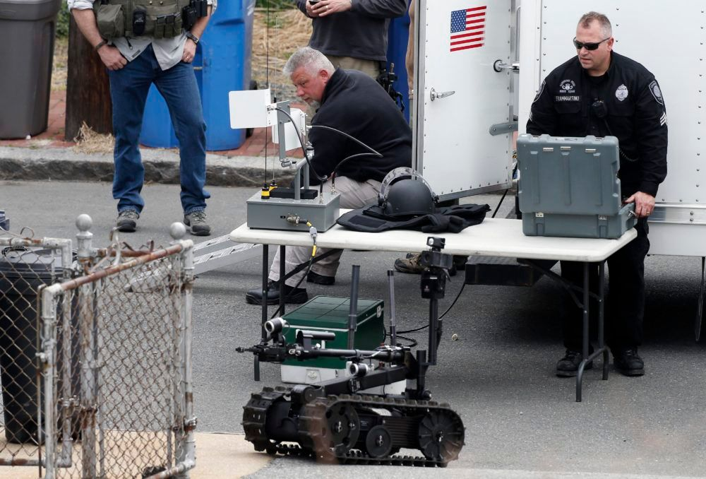 Robots and police departments are no strangers. In this photo, a member of the Cambridge police bomb squad used a robot during a search for the Boston Marathon bombings suspect in 2013.