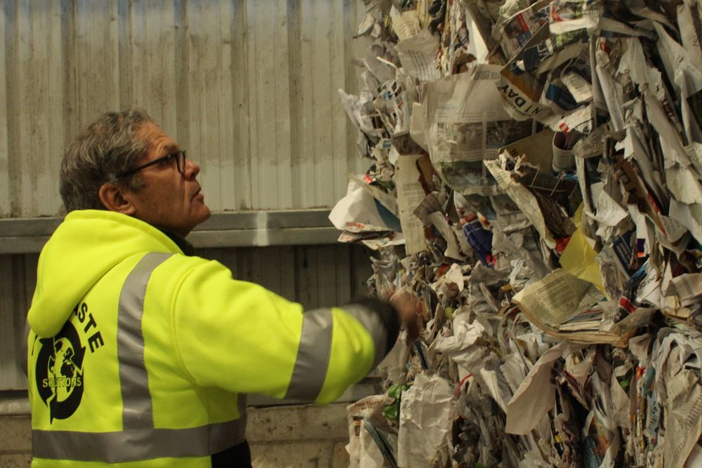 Tim Flanagan examines a bale of paper for contamination.