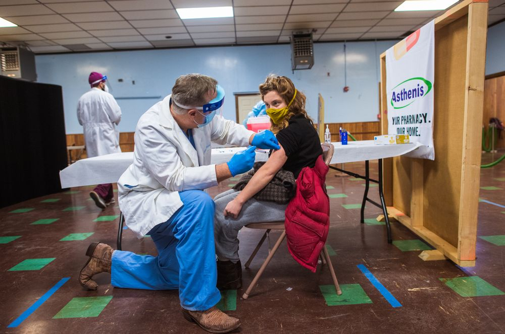 """The last patient of the day to be vaccinated is Bea Mandel, 23, of Providence. She works in a furniture store in Central Falls and a friend sent her the link to register because the clinic had unused doses. """"I'm thrilled,'' she said. """"I'm younger and stuff so I didn't expect to get it until like July.''"""