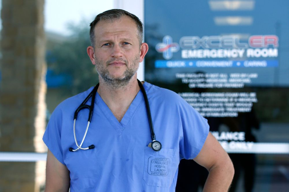 Dr. Nathaniel B. Ott, M.D. poses for a photo outside EXCELER emergency room Sunday, Sept. 1, 2019, in Odessa, Texas. Ott attended to one of Saturday's shooting outside his center. (AP Photo/Sue Ogrocki)