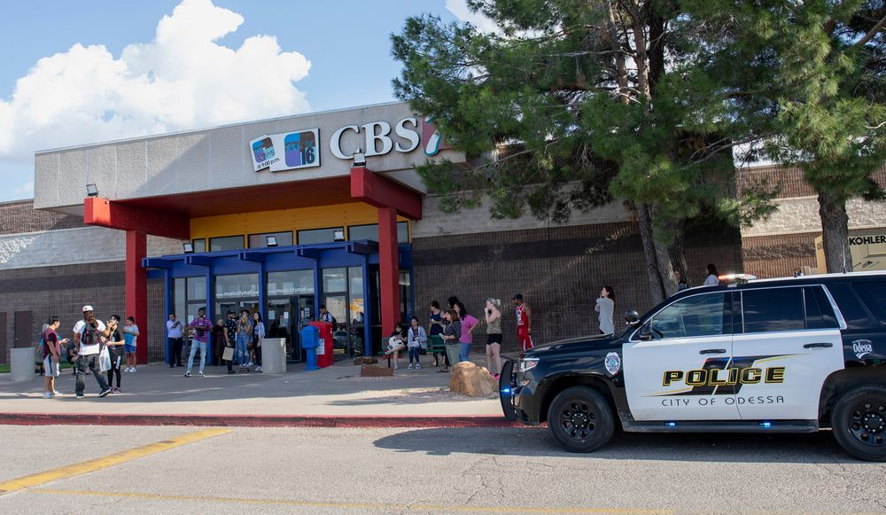 Odessa police officers park their vehicle outside Music City Mall in Odessa, Texas, Saturday, Aug. 31, 2019, as they investigate areas following a deadly shooting in the area of Odessa and Midland. Several people were dead after a gunman who hijacked a postal service vehicle in West Texas shot more than 20 people, authorities said Saturday. The gunman was killed and a few law enforcement officers were among the injured. (Jacy Lewis/Reporter-Telegram via AP)