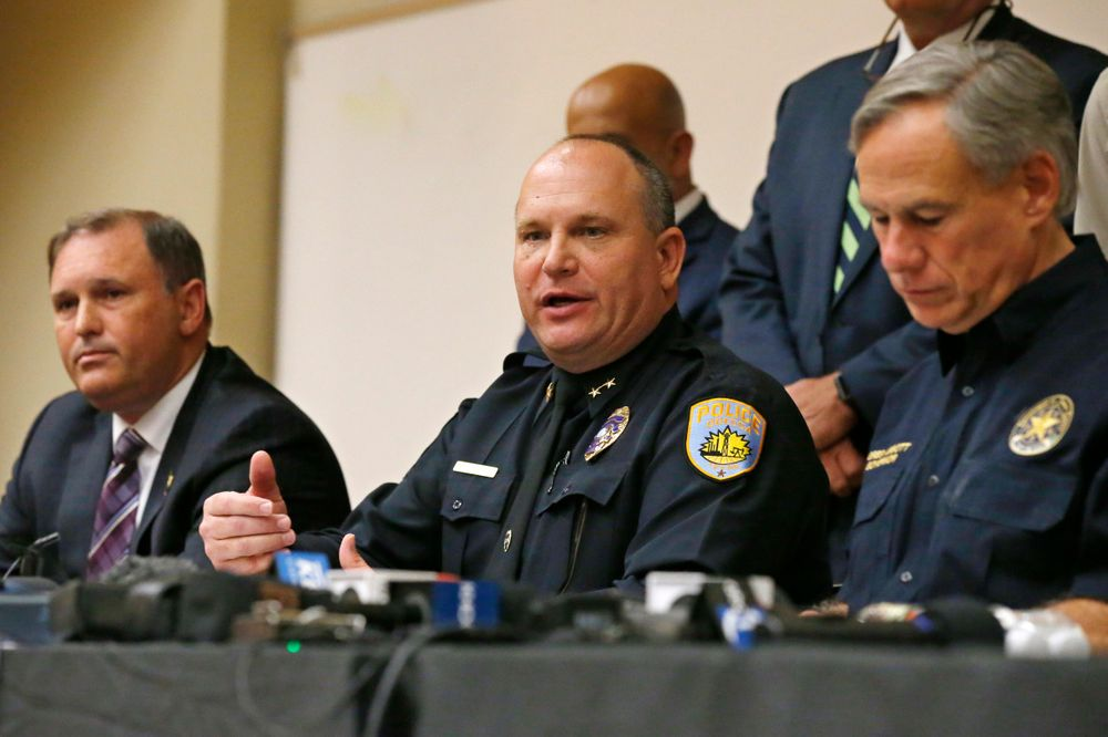 Odessa Police Chief Michael Gerke, center, answers a question concerning Saturday's shooting during a news conference Sunday, Sept. 1, 2019, in Odessa, Texas. From left are Christopher Combs, FBI Special Agent in Charge, San Antonio, Gerke, and Texas Governor Greg Abbott. (AP Photo/Sue Ogrocki)