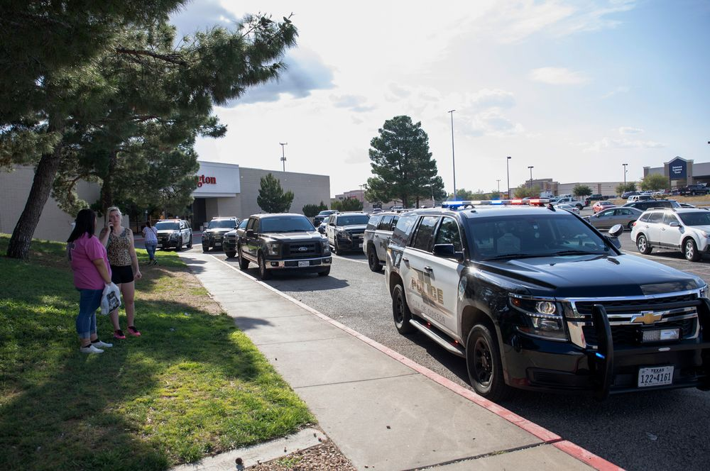 Odessa police officers park their vehicles outside Music City Mall in Odessa, Texas, Saturday, Aug. 31, 2019, as they investigate areas following a deadly shooting in the area of Odessa and Midland. Several people were dead after a gunman who hijacked a postal service vehicle in West Texas shot more than 20 people, authorities said Saturday. The gunman was killed and a few law enforcement officers were among the injured. (Jacy Lewis/Reporter-Telegram via AP)
