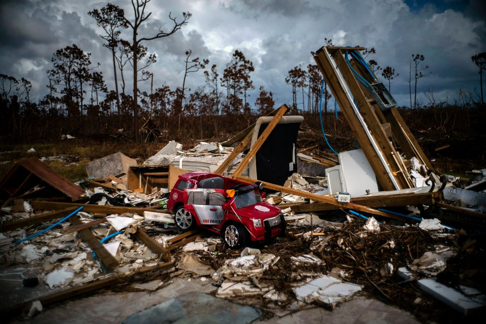 A toy fire engine sits in the rubble of a house destroyed by Hurricane Dorian in Gold Rock Creek, Grand Bahama, Bahamas, Thursday Sept. 12, 2019. Nearly two weeks after Hurricane Dorian hit the northern Bahamas, people continue to scan social media, peer under rubble or follow the smell of death in an attempt to find family and friends. (AP Photo/Ramon Espinosa)