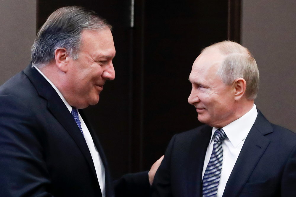 Russian President Vladimir Putin, right, and U.S. Secretary of State Mike Pompeo, greet each other prior to their talks in the Black Sea resort city of Sochi, southern Russia, Tuesday, May 14, 2019. Pompeo arrived in Russia for talks that are expected to focus on an array of issues including arms control and Iran. (AP Photo/Pavel Golovkin, Pool)